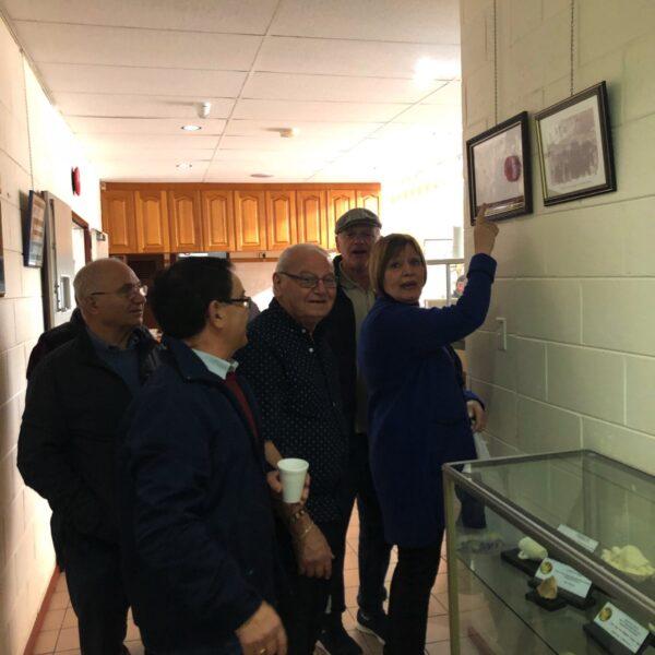 Market visitors appreciating many photos and artifacts